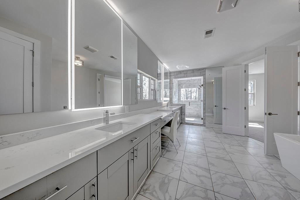 Gray And White Kitchen & Spacious Bathroom Renovation And Home Addition